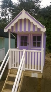 Beach hut in purple and white